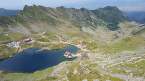 Wide view of mountain valley , cottages and  alpine lake Stock Photography