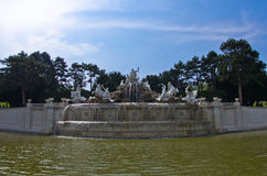 Wide view of Neptune fountain in front of Schenbrunn park and palace in Vienna Royalty Free Stock Image