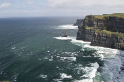 Wide view of O' Briens Tower atop Cliffs of Moher Stock Image