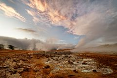 Iceland - volcanic landscape - geothermal area with steam outlet stock photos