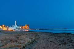 Wide view of Punta Secca at blue hour. Wide view of Punta Secca, a small fishing village in the province of Ragusa (Sicily), at blue hour Royalty Free Stock Photos