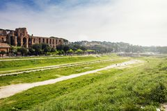 Wide view of the remains of the Circus Maximus of Rome. With the ruins of the Domus Severiana in the background Royalty Free Stock Images