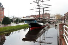 Wide view on a sailor ship and its reflection and the landscape around at the canal in papenburg germany. Photographed with wide angle lens during a sightseeing royalty free stock photography