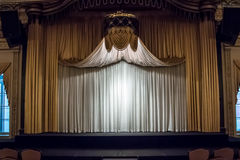 Wide View of Stage. The curtain is drawn on a stage in a ballroom royalty free stock photo