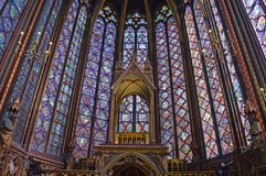Wide view  Beautiful stained glass windows in the upper level interior Sainte-Chapelle Paris France. Wide view of Stained Glass windows at the upper level Stock Image