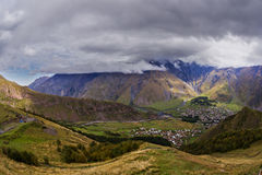 Wide view on Stepantsmidna village from Gergetti, Georgia. The Wide view on Stepantsmidna village from Gergetti, Georgia Royalty Free Stock Image