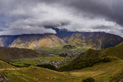 Wide view on Stepantsmidna village from Gergetti, Georgia. The Wide view on Stepantsmidna village from Gergetti, Georgia royalty free stock images