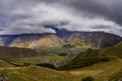 Wide view on Stepantsmidna village from Gergetti, Georgia. Wide view on Stepantsmidna village from top of Gergetti, Georgia royalty free stock photo