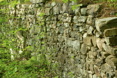Wide view of stone wall from ruins of a mill. Royalty Free Stock Photo