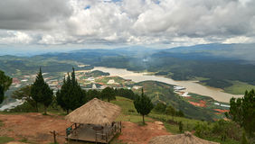 Wide view with storm and rain clouds from the mountain lang biang in Da-lat, Vietnam. Dramatic sky before the rain. Wide view with storm and rain clouds from the Royalty Free Stock Image