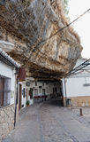 Wide view of street between the rocks .  Setenil de las Bodegas Stock Photo