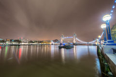 Wide view of Thames river with the Tower Bridge. A wide riverscape view of the Thames river, with the famous Tower Bridge on the background, in London Stock Images