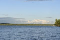 Wide Volga river. On the right Bank you can see the forest. Private berths for boats and boats royalty free stock images