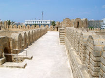 Wide wall of Ribat (fortress) in the town of Sousse. Royalty Free Stock Photo