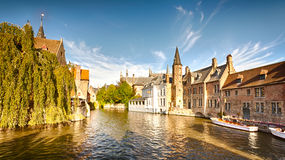A wide water canal with old buildings stock photos
