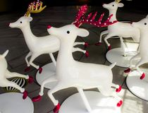 Wide white reindeer in front of the department store. Royalty Free Stock Image