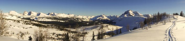 Wide Winter Panoramic Landscape Canadian Rocky Mountains Banff National Park. Wide Panoramic Winter Scenic Landscape View of Snowy Mountain Peaks and Sunshine royalty free stock photos