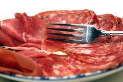 widelce ciał płytkę prosciutto salami Zdjęcia Stock