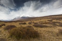Widely field. Mountain and cloud in dramatic royalty free stock photos