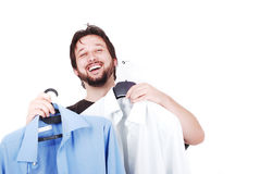 Widely smiled man with blue and white shirts. White elegant man with two fasion shirts in hands Royalty Free Stock Images