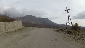 Widening the old road in the mountains,GoPro. Reconstruction of the old road in the mountains, Go Pro stock footage