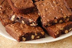 Wider view of fresh baked brownies. Freshly baked peanut butter chip brownies royalty free stock photography