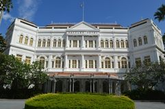 Wider view of Front Facade of Raffles Hotel Beach Road Singapore. Front facade of Raffles Hotel is a colonial-style luxury hotel in Singapore on Beach Road. Very Royalty Free Stock Images