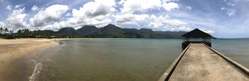 Widescreen Panorama View of Hanalei Pier and Bay, Kauai, Hawaii, USA royalty free stock images