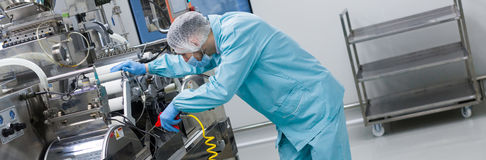 Widescreen picture, factory worker work with machine, steel mach Stock Photography