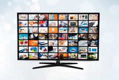 Widescreen ultra high definition TV screen with video broadcast Royalty Free Stock Photo
