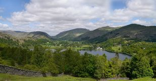 Widescreen view over Grasmere, it's lake and backgound mountains. Looking down on Grasmere from the south, widescreen Stock Photo