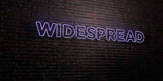 WIDESPREAD -Realistic Neon Sign on Brick Wall background - 3D rendered royalty free stock image. Can be used for online banner ads and direct mailers Stock Photography