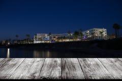 Widok Cypr miasteczko nad starym lekkim drewnianym stołem lub deską Collag zdjęcia stock