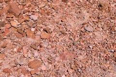 Widok jaskrawa czerwieni ziemia, tło, tekstura zdjęcia royalty free