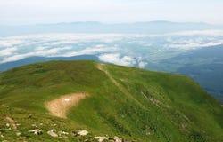 Widok od góry Petros na chmurach Obrazy Stock