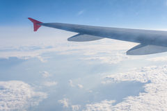 Widok od samolotu na chmurach i skrzydle Obrazy Royalty Free