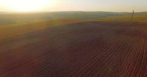 Widok z lotu ptaka kultywujący pola wśród zadziwiać krajobrazy 4K zbiory