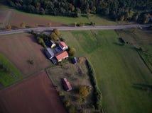 Widok z lotu ptaka: Miasteczko, pola i drzewa w jesieni, Zdjęcia Royalty Free