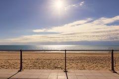 Widok zaciszności plaża i kruszcowy ogrodzenie Obrazy Royalty Free
