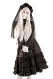 Widow doll girl. Widow in a black dress with white eyes looking like a doll isolated in white Stock Photos