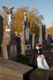 Widow in graveyard Royalty Free Stock Image