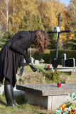 Widow at graveyard in fall Stock Images