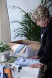 Widow longing for dead husband. Elderly widow longing for the dead husband royalty free stock image