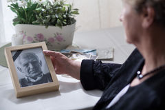 Widow looking at the photo. Of her dead husband Royalty Free Stock Images