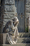 Widow marble statue outside a tomb Stock Image