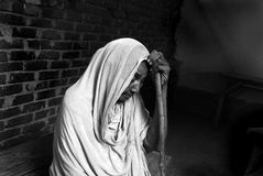 Widow in a medical camp. A poor old widow are waiting for the doctor in a temporary medical camp Royalty Free Stock Photography