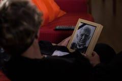 Widow mourning dead person. Portrait of elderly widow mourning dead close person Stock Photos