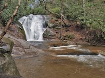 Widow`s Creek Falls at Stone Mountain State Park. Widow`s Creek Falls in Stone Mountain State Park in Low Gap, North Carolina drops about 25 feet before emptying stock images