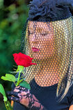 Widow with veil and rose. A young, grieving widow with a veil and rose. death and inheritance Royalty Free Stock Images