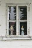 Widow in wooden building Stock Photos
